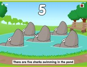 Five Sharks Swimming